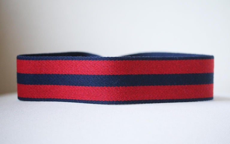 Reinvent your bag with this Hermès Bag Strap. Bag strap in canvas and Swift calfskin leather. Gold plated hardware. Large snap hook. Colour: red and blue. Does not come with a dustbag.   Dimensions: L 105 x W 5 cm  Condition: New without tags.