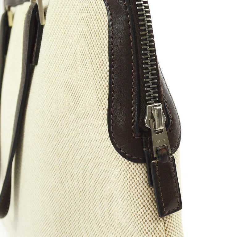 Hermes Tan Brown Canvas Carryall Bowling Evening Top Handle Satchel Tote Bag   Canvas Leather trim Silver tone hardware Date code present Made in France Handle drop 5