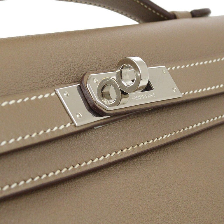 Leather  Palladium plated hardware Leather lining  Turn-lock closure Made in France Top Handle 0.75