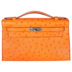 Hermès Tangerine Ostrich Kelly Pochette PHW