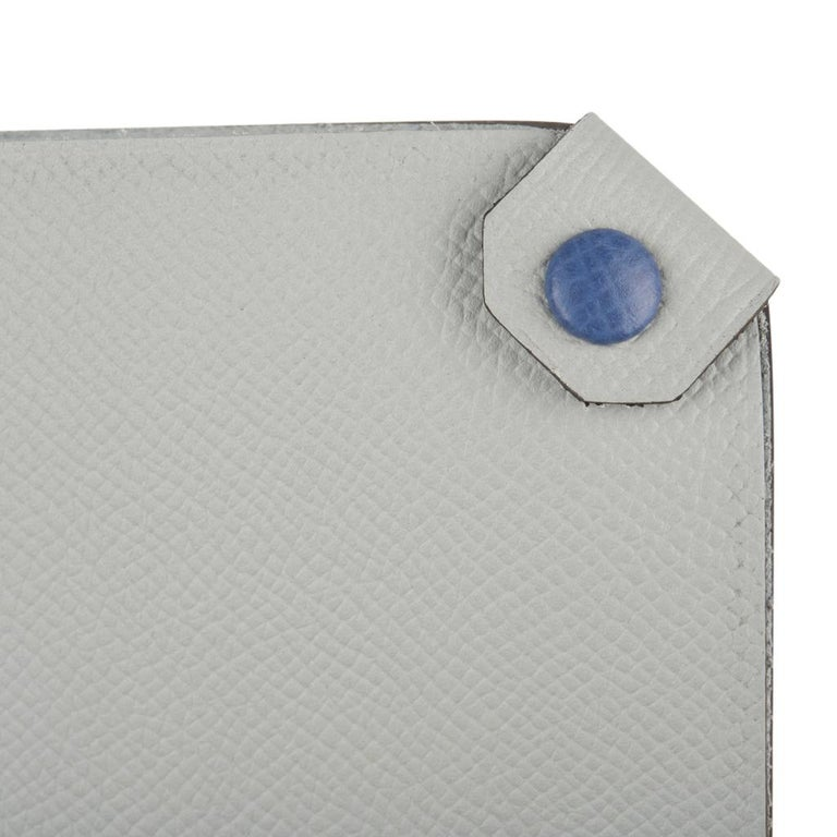 Guaranteed authentic Hermes Tarmac Passport Holder with bi color feature. Blue Glacier epsom leather with Blue Brighton snap.  Spoil yourself, or gift this luxury touch for travel.   Comes with the signature Hermes box and ribbon. Please additional