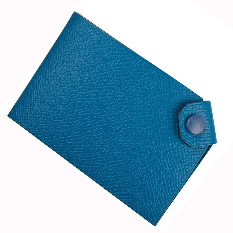 Guaranteed authentic Hermes Tarmac Passport Holder with bi color feature. Blue Izmir epsom leather with Blue Brighton snap. Spoil yourself, or gift this luxury touch for travel.   Comes with the signature Hermes box and ribbon. Please additional