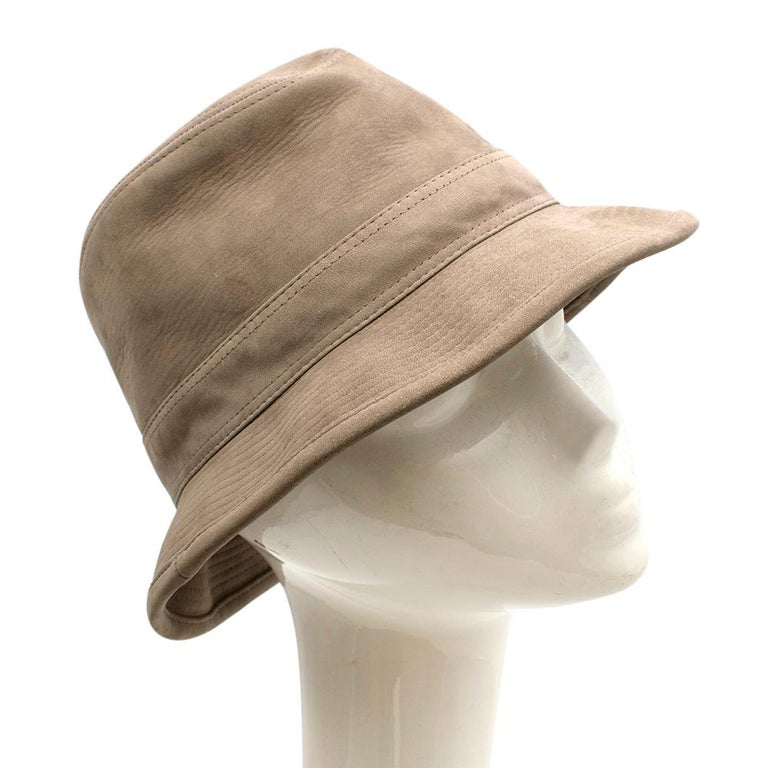 Hermes Taupe Suede Bucket Hat  - Ribbed Stitch Brim  - Sewn in Hat Band  - Lined With Signature Fabric   Material: -100% Suede  Made in France   Circumference: 57cm Diameter: 27cm
