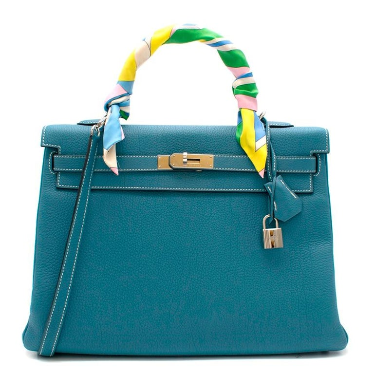 Hermes Togo Leather Blue Jean Kelly 35 PHW  Age [P] 2012 Palladium Plated Hardware -Removable shoulder strap  -Clochette & keys  -Silk colourful twilly included   - Interior zip pocket - Two interior slip pockets  This item can be viewed at our