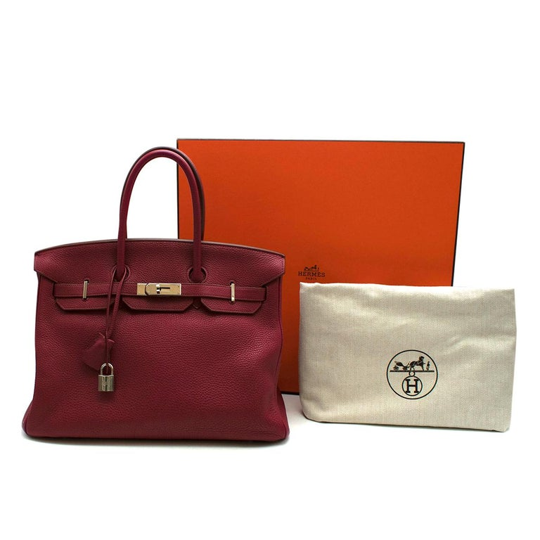 Hermes Togo Leather Rubis Birkin 35 PHW  The most desired Hermes bag, the Birkin is a timeless style with a better investment rate than Gold! This 35, the most popular style is in a soft ruby red which contrasts beautifully with the palladium plated
