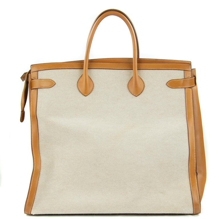 Hermes Toile & Vache Natural Weekend Bag. This iconic special order Hermes Weekend bag is timeless and chic. Fresh and crisp with gold hardware.      Condition: New or Never used     Made in France     Bag Measures: 17