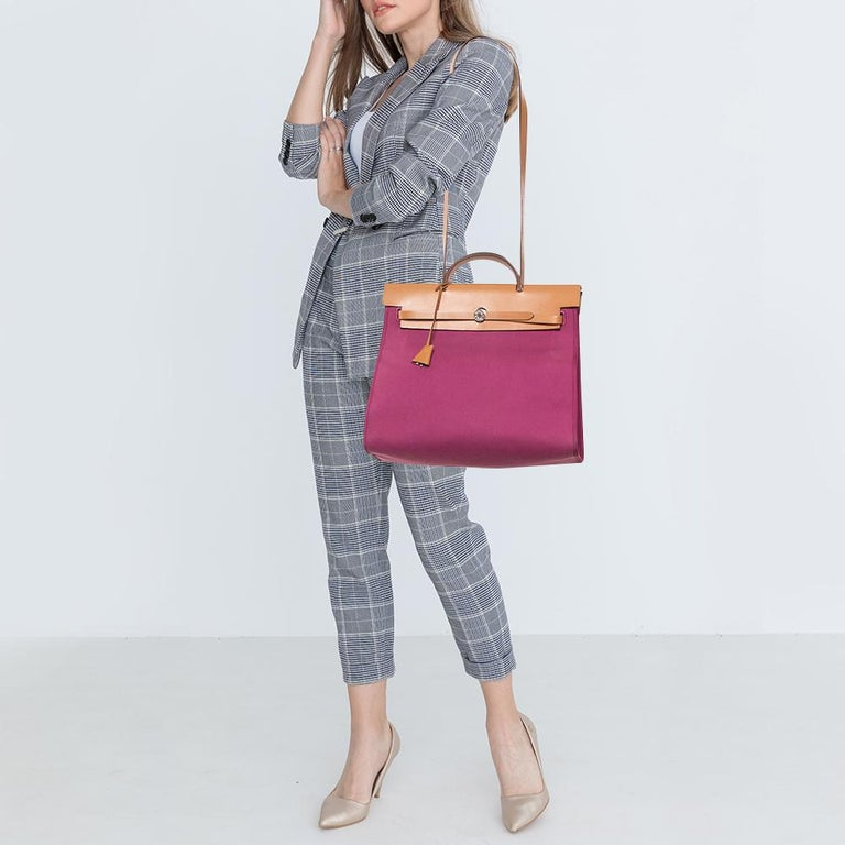 Made from canvas and leather, the Herbag Zip is just as outstanding as all of Hermes' other handbags. First introduced in 2009 as a new version of the Herbag, this piece comes with a single handle, a long shoulder strap and it flaunts a fine