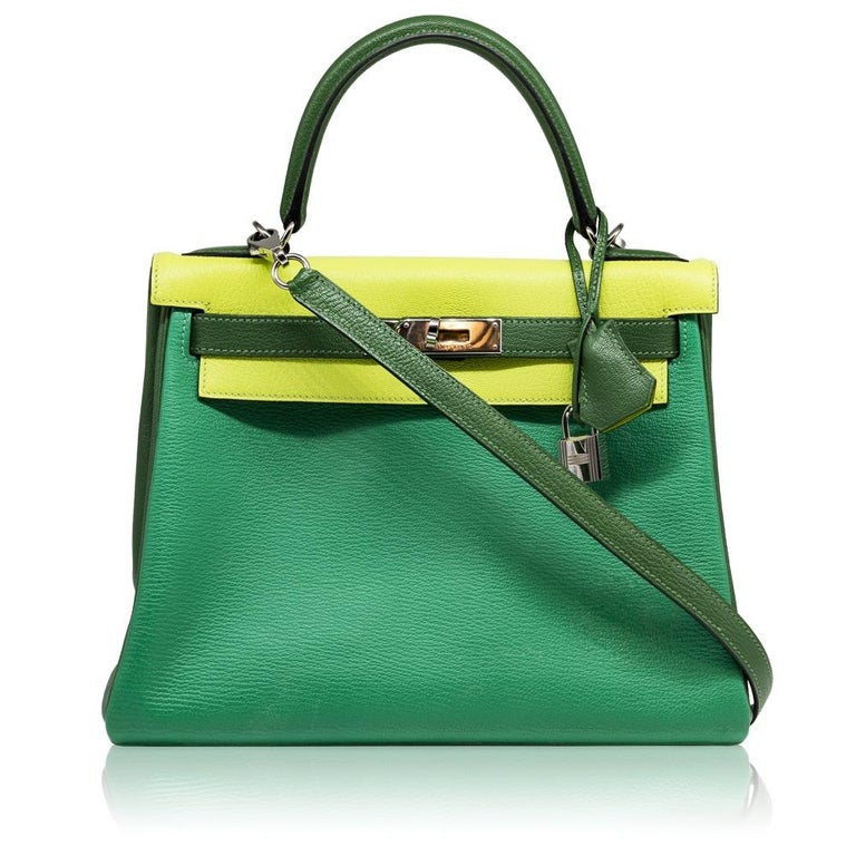 Crafted in Chevre Mysore, a goatskin leather popular for its lightweight, soft grain texture and scratch-resistance, this rare, limited edition of the Hermès Tri-Colour Kelly Retorne bag is a true testament to the quality of the house's