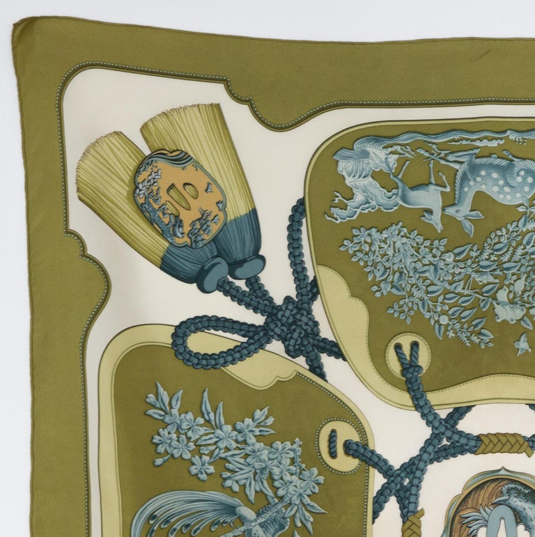 Hermes silk scarf Tsubas by Christiane Vauzelles featuring a kakhi border. First issued in 1991  In good vintage condition. Made in France. 35,4in. (90cm)  X 35,4in. (90cm) We guarantee you will receive this  iconic item as described and showed on
