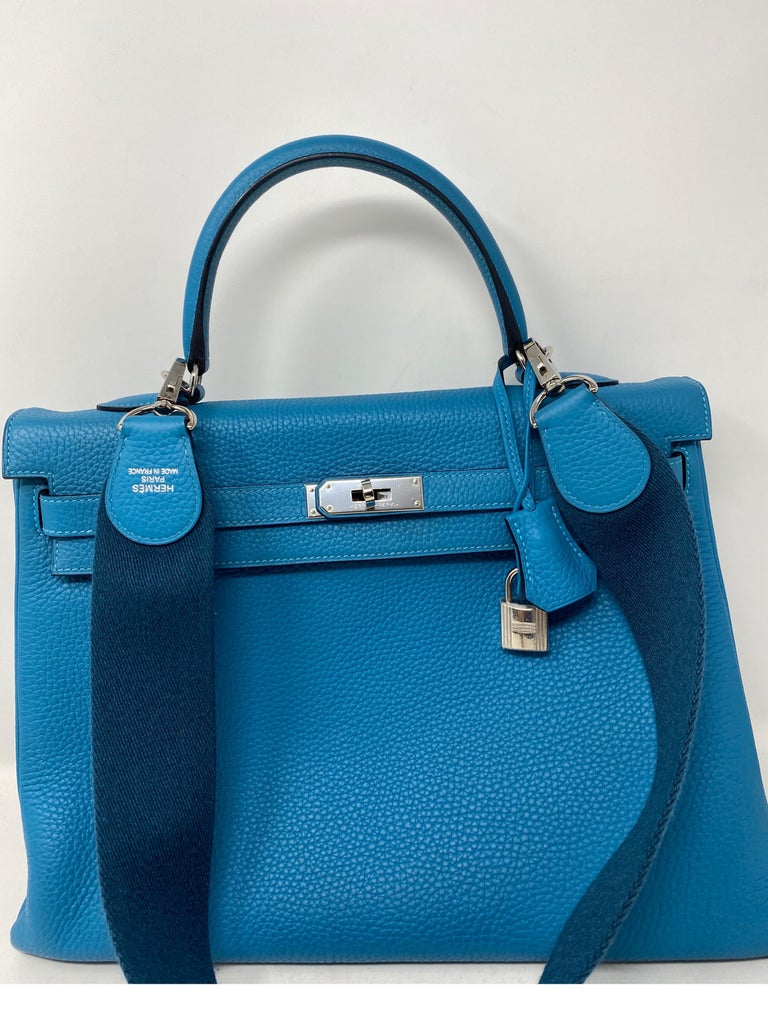 Hermes Kelly 35 Turquoise Amazone Taurillon Clemence Leather Bag. Turquoise and Colvert strap. Like new condition. Beautiful bag and unique strap. Comes with original receipt. From 2014. Includes clochette, lock, keys, and dust bag. Guaranteed