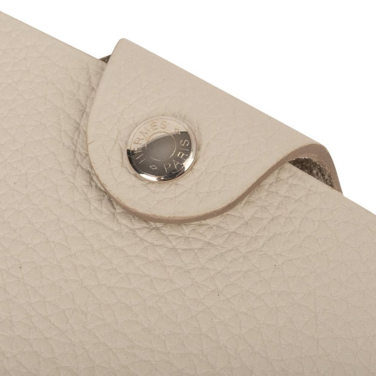 Guaranteed authentic Hermes Ulysse small model notebook cover features Craie togo leather. Palladium Clou de Selle  snap.  Comes with a new Ulysse Arpege notebook refill.    Each item comes with the signature Hermes box and ribbon. New or Store
