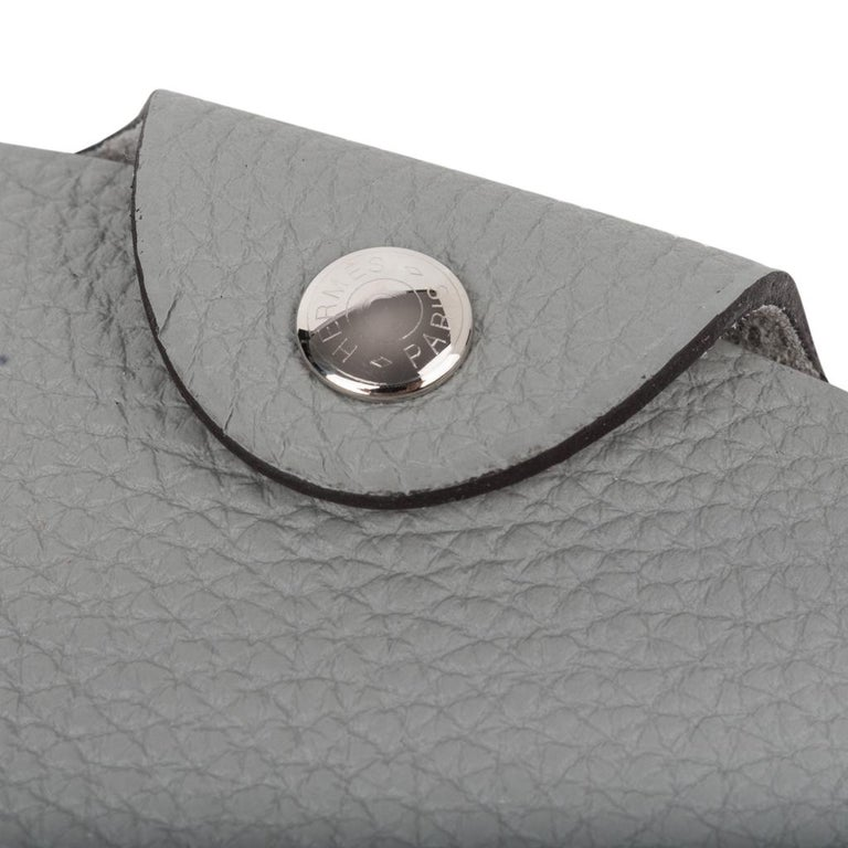 Guaranteed authentic Hermes Ulysse PM model notebook cover features Gris Mouette togo leather. Palladium Clou de Selle  snap.  Comes with a new notebook lined refill.  Each item comes with the signature Hermes box and ribbon. New or Store Fresh