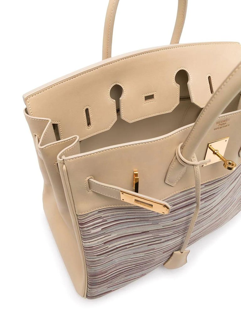 Crafted in France, this limited edition and highly sought over pre-owned Birkin Vibrato bag from Hermès is a true testament to the quality of the house's craftsmanship, exuding timeless style and elegance. 35cm in size, this unique piece features a