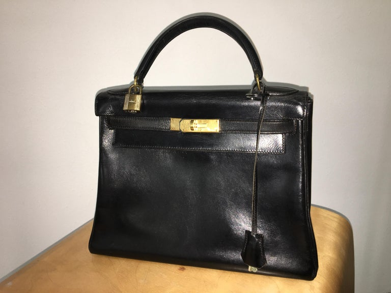 Vintage black leather Kelly bag. Featuring a trapeze body, top flap closure  with twist 54af13f1bf