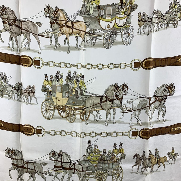 HERMES Silk scarf named 'Attelages a Quatre (1820-1860)/ Four in Hand', created by artist Philip Ledoux, and first issued in 1970. Brown borders. 100% Silk. Hand rolled edges. Approx measurements: 35 x 35 inches - 88,8 x 88,8 cm   Details  MATERIAL: