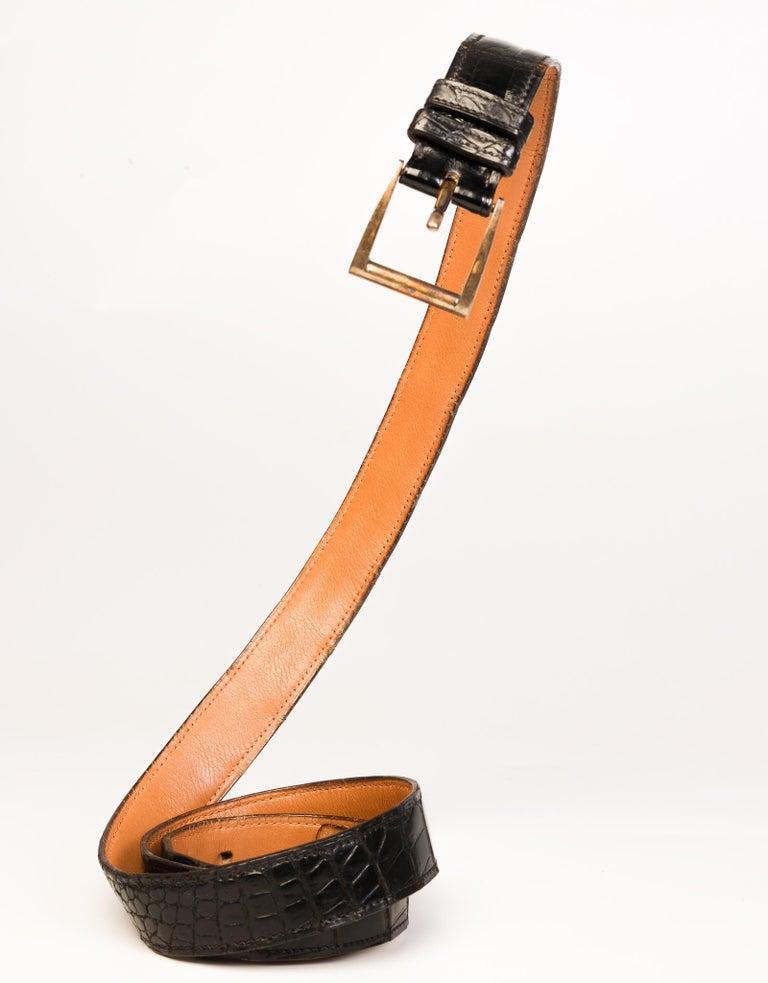Black crocodile leather vintage Hermes belt with gold-tone buckle.   COLOR: Black MATERIAL: Leather MEASURES: L 45