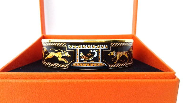 Beautiful Authentic Hermès Bracelet  Pattern: Lévriers (Greyhound dogs)  Hard to find !   Made in Austria + B (1998)  Made of Enamel and Gold plated Hardware  Colorways: Black, Yellow, Camel, Brown  The collars, leashes and the interlacing