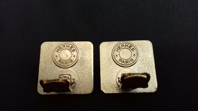 Women's Hermès Vintage Golden and Silver Metallic Clip-On Medor Earrings For Sale