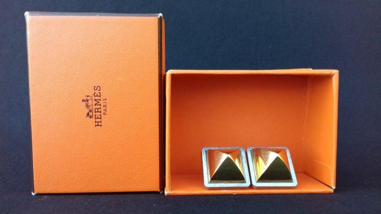 Hermès Vintage Golden and Silver Metallic Clip-On Medor Earrings For Sale 1