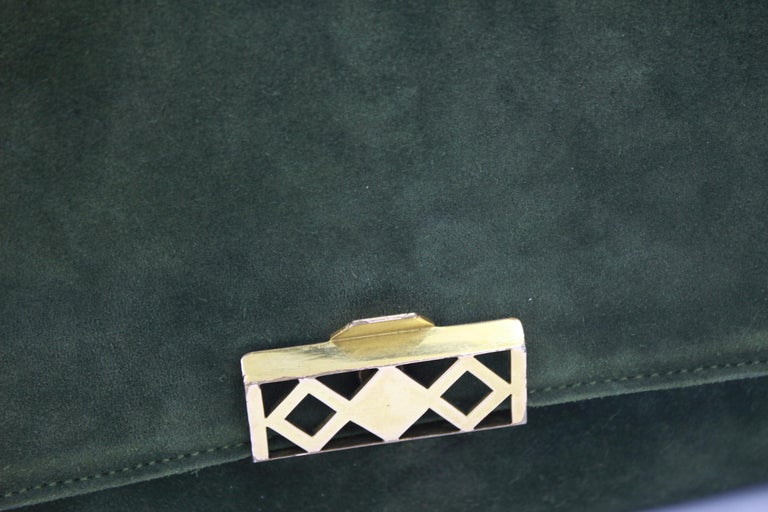 Really nice hard to find Hermes 60's grille bah in green suede and leather. Bag in good vintage condition no major defect but some signs of use. Stamp