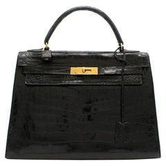 Hermès Vintage Kelly Sellier 32 in Black Niloticus Crocodile GHW