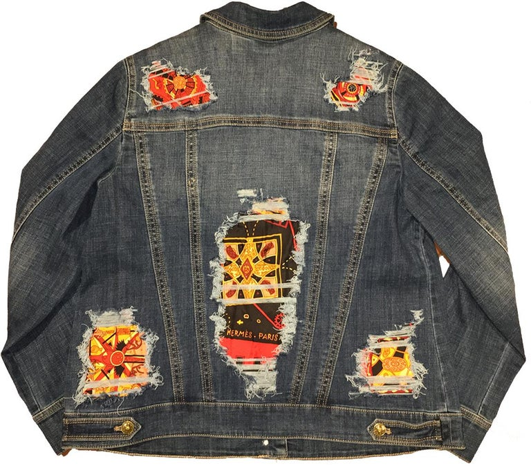Hermes Vintage La Mecanique des Idees Silk Scarf distressed denim jacket in NWOT condition. Medium weight denim jacket with gentle stretch and soft woven cotton. Hand distressing throughout with hermes silk scarf patches peaking through and filling