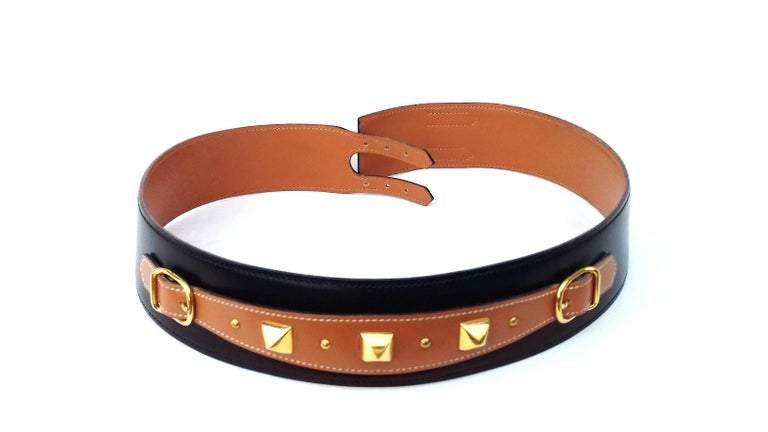Beautiful Authentic Vintage Hermès Belt  Made in France  Stamp O in a circle (1985)  Made of Black Box Leather (smooth)  The front ornament is made of Gold smooth Leather, adorned with pyramids (