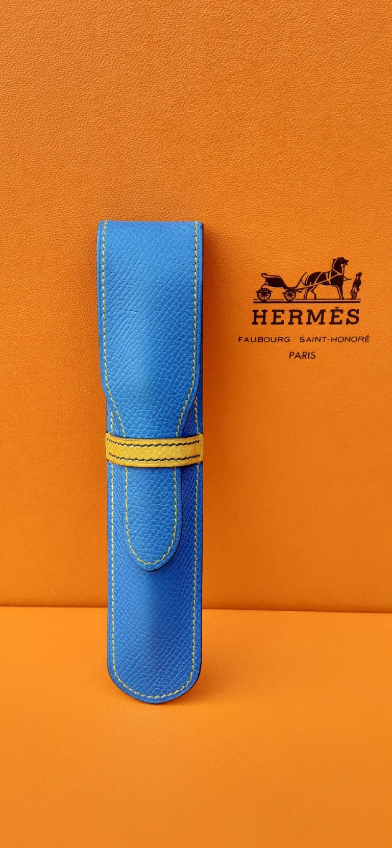 Beautiful Authentic Hermès Pen Case  Made in France  Stamp T in circle (1990)  Made of Courchevel (ex Epsom) Leather  Colorway: Blue, Yellow