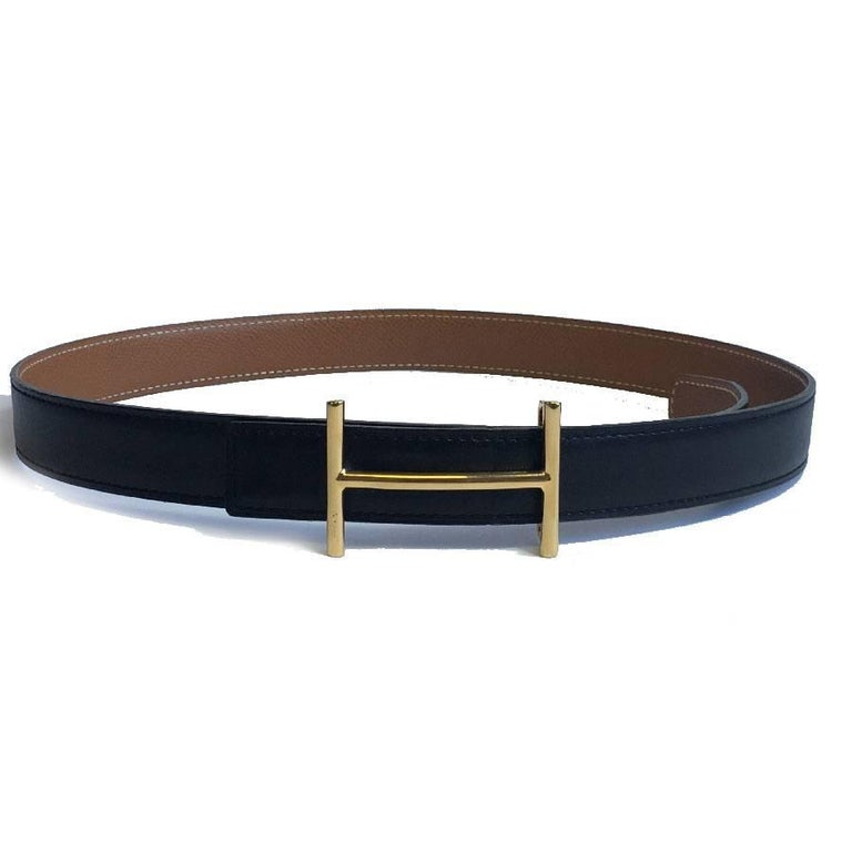 Hermès belt vintage reversible black box leather and epsom gold leather. Size 78.  Buckle H in fine gold plated. Stamp A in a square (1997)  In very good condition. Made in France  Dimensions: total length: 93 cm, first hole: 70 cm, middle: 75 cm,