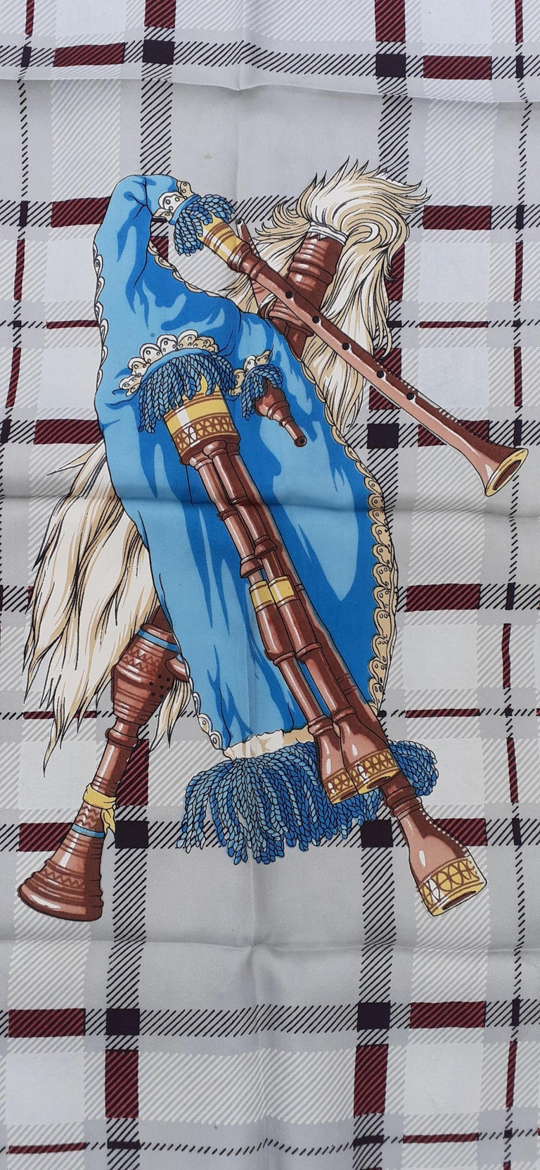 Extremely Rare Authentic Hermès Scarf  Pattern: Bagpipe (Cornemuse)  The drawing shows in its center a bagpipe, surrounded by 4 hands each holding a flower, emblem of the countries of the United Kingdom: Rose for England, Clover for Northern