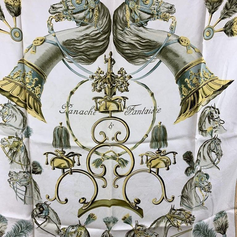 Rare vintage silk scarf named 'PANACHE ET FANTASIE' designed for Hermes by Hugo Grygkar. This scarf was issued for the first time in 1959.  - Title: 'PANACHE ET FANTASIE' by Hugo Grygkar - It first issued in 1959 - 100% Silk - Main colors: White,