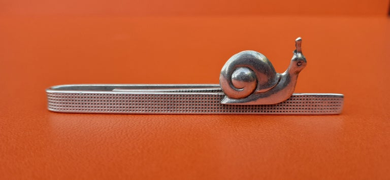 Authentic Hermès Tie Pin  Pattern: Cute Snail  Probably a vintage item  Made of Stering Silver