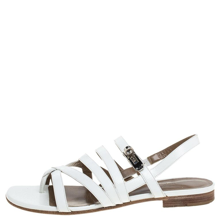 Cut from excellent quality white leather, this pair of strappy flat sandals designed by Hermes is easy to flaunt footwear option. Originated in Itlay, Hermes is known as a leading powerhouse of leather accessories and other high-end products. The
