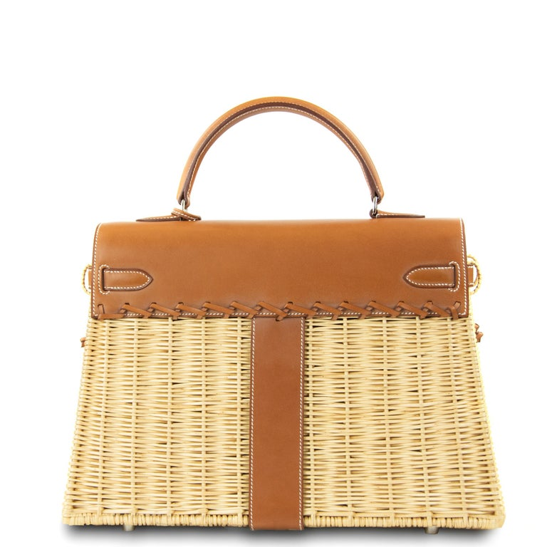 This limited edition Hermes Kelly bag is a truly rare collectors item.  Stunning woven wicker basket with Hermes Barenia leather.  Features palladium hardware.  Kelly detachable strap is made of barenia leather and embellished with incredible