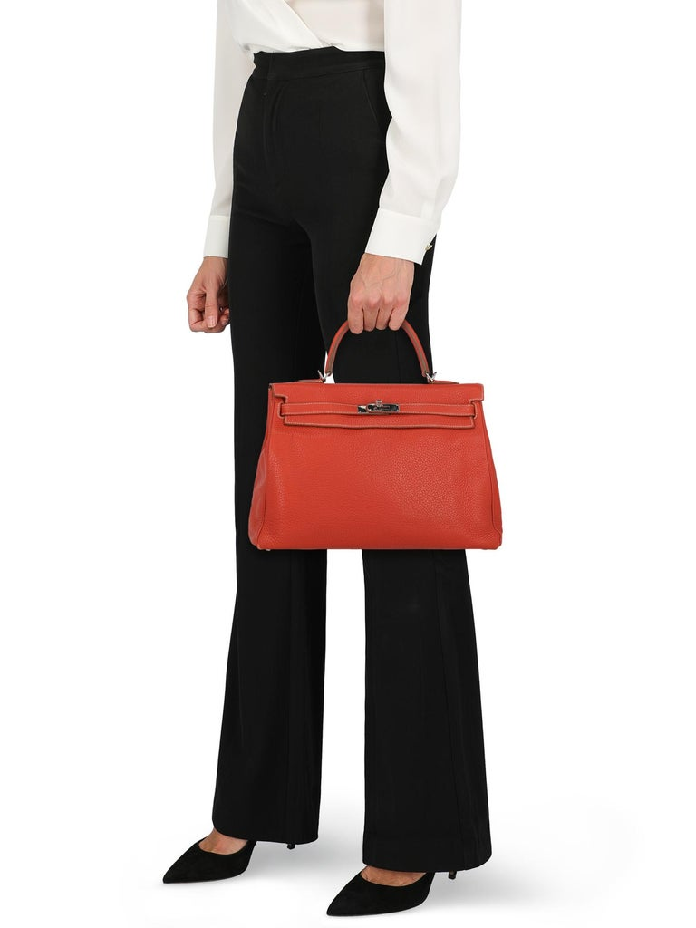 Kelly 35, sanguine, taurillon clemence, leather, solid color, logo placard, removable shoulder strap, silver-tone hardware, internal zipped pocket, leather lining, day bag. Product Condition: Very Good. Lining: negligible scratches. Hardware: