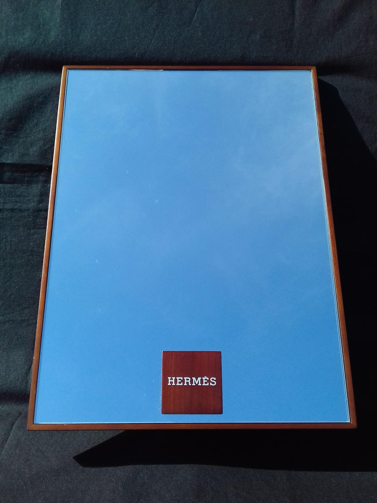 Authentic Hermès Mirror  The mirror is surrounded by a wooden frame  The base is a rectangle of wood