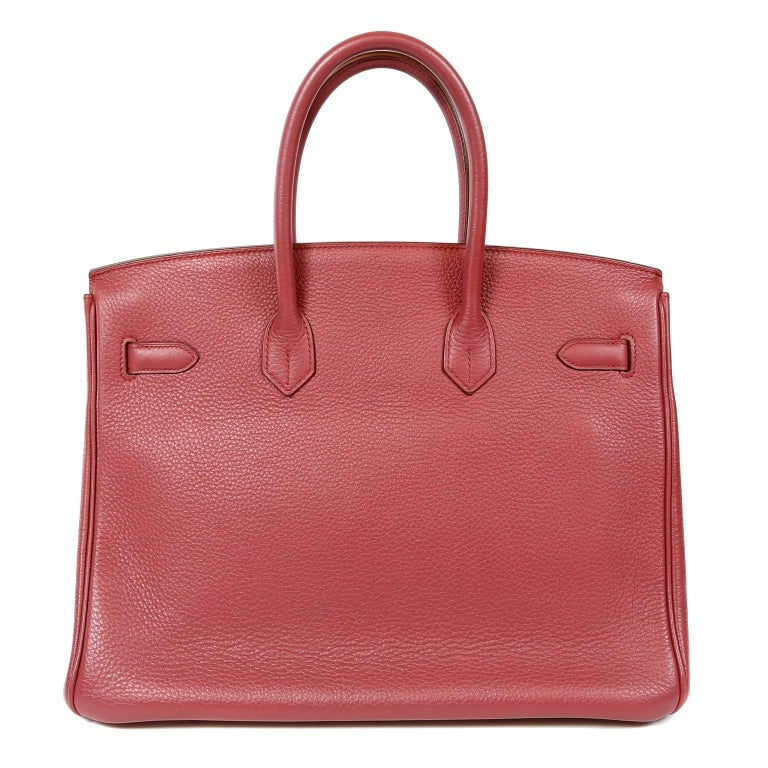 Hermès Bois de Rose Togo Leather 35 cm Birkin- PRISTINE; never carried with the protective plastic intact on the hardware.  Hand created, Hermès bags are highly sought after and can be nearly impossible to get.  Bois de Rose is a subdued shade of