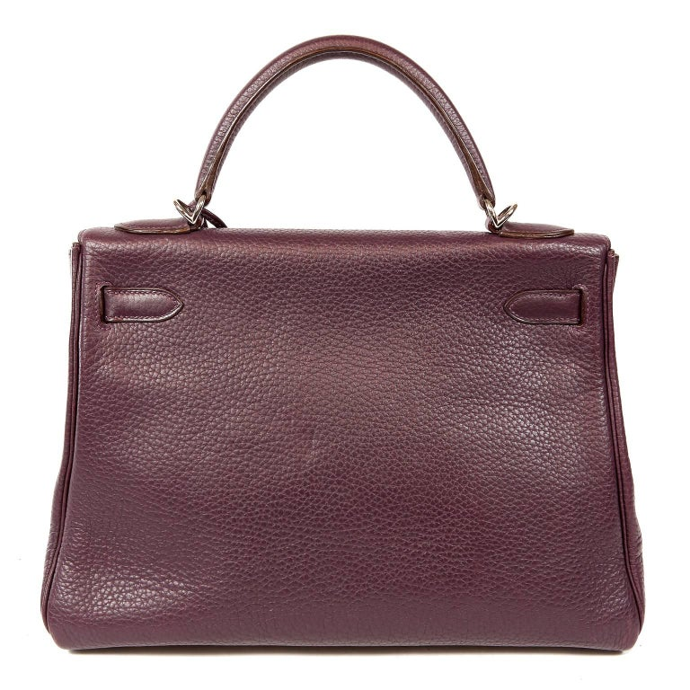 Hermès Raisin Togo 32 cm Kelly- Excellent Plus Condition Hermès bags are considered the ultimate luxury item worldwide.  Each piece is handcrafted with waitlists that can exceed a year or more.  The ladylike Kelly is classic and refined, a beautiful