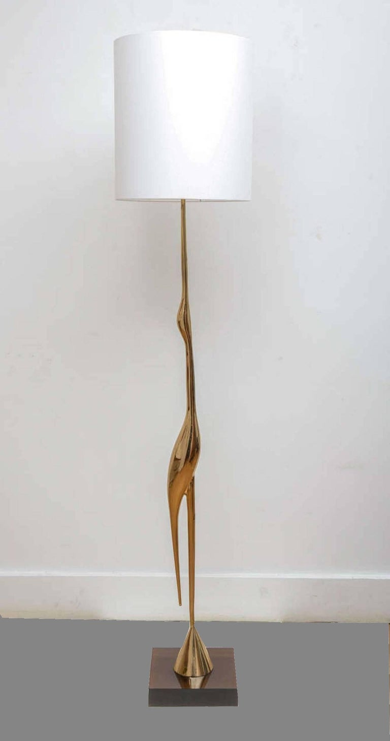 """Polished bronze """"He´ron"""" floor lamp, circa 1970, by René Broissand (born in 1928). On a square brown Lucite base. Signed and numbered 14. New lampshade redone as original.  Dimensions without lampshade are: Height 171 cm. Square base 30 x 30"""