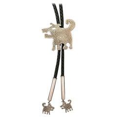 Hershey & His Twin Sons, Rez dog bola tie, Melanie Yazzie designs leather silver