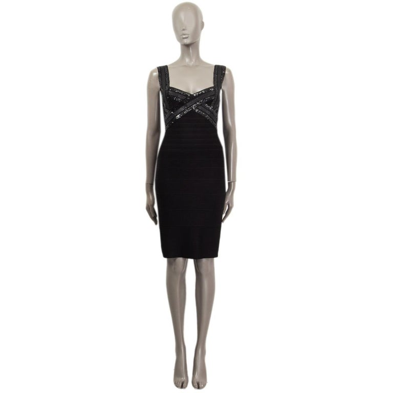100% authentic Herve Leger sleeveless bandage dress in black rayon (90%), nylon (9%) and spandex (1%). Embellished with black sequins on the front and the back. Closes with one hook-and-eye closure and concealed zipper on the back. Unlined. Has been