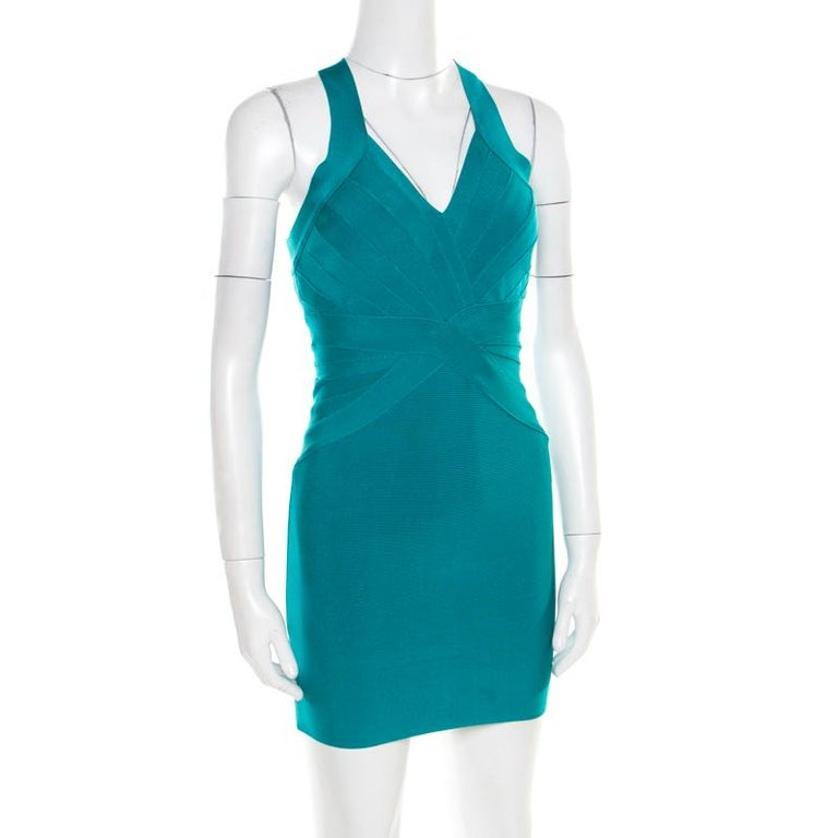 Every detail of this dress from Herve Leger makes a statement and imparts a chic finish. It features a bandage construction that creates a sleek silhouette and a plunging neckline. The stunning jade green colour along with rear zip fastening further