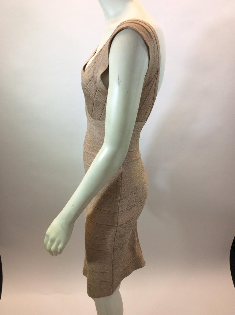 Herve Leger Nude and Gold Tone Bandage Dress $450 Made in China 90% Rayon, 9% Nylon, 1% Spandex Size small Length 38