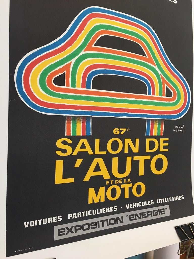 Herve Morvan - Original vintage poster, 'Auto and Motorcycle Show', 1980  Herve Morvan is a French artist from the 1950s that designed many posters using humorous happy characters. This is an original vintage advertising poster.   Artist: