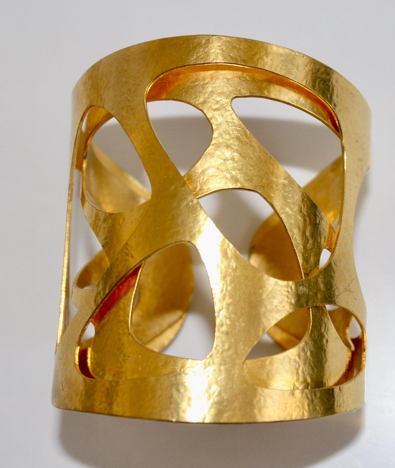 Gilded brass Giraffe cuff from Herve van der Straeten. This designer is no longer producing jewelry, making all remaining pieces collectors items. Cuff is adjustable, fits wrists both large and small.