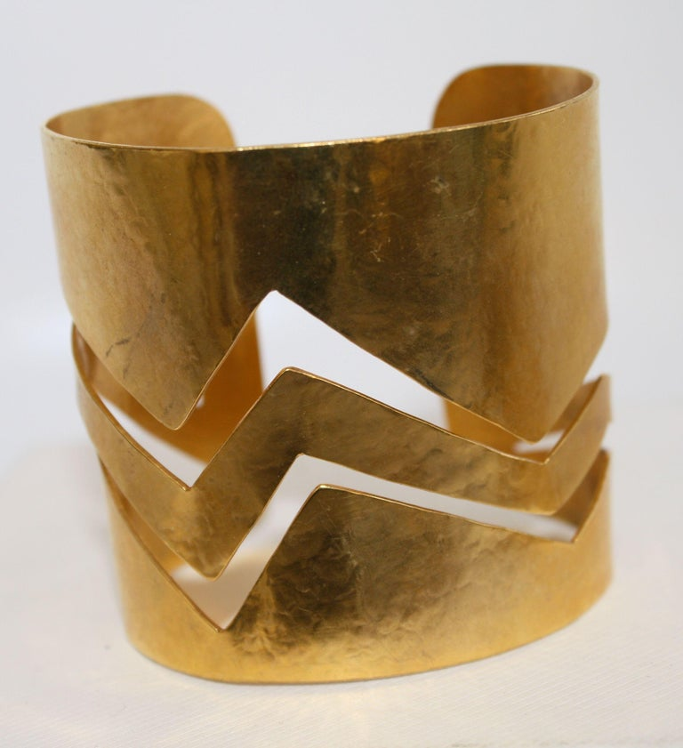 Gilded bronze malleable cuff in zig-zag pattern from Herve van der Straeten. This designer is no longer designing jewelry, making all remaining pieces collectors items!