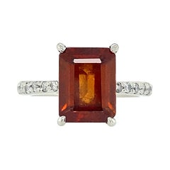 Hessonite Garnet in Platinum Solitaire Ring with Pavé Diamond Shoulders