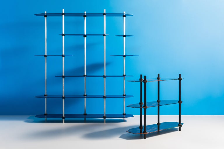 "Hex Shelving is designed entirely around factory-made ""shaft collars"" which clamp onto the posts to secure the shelves. This blend of the low fi with ultra-high levels of finish quality gives the piece it's compelling uniqueness. 