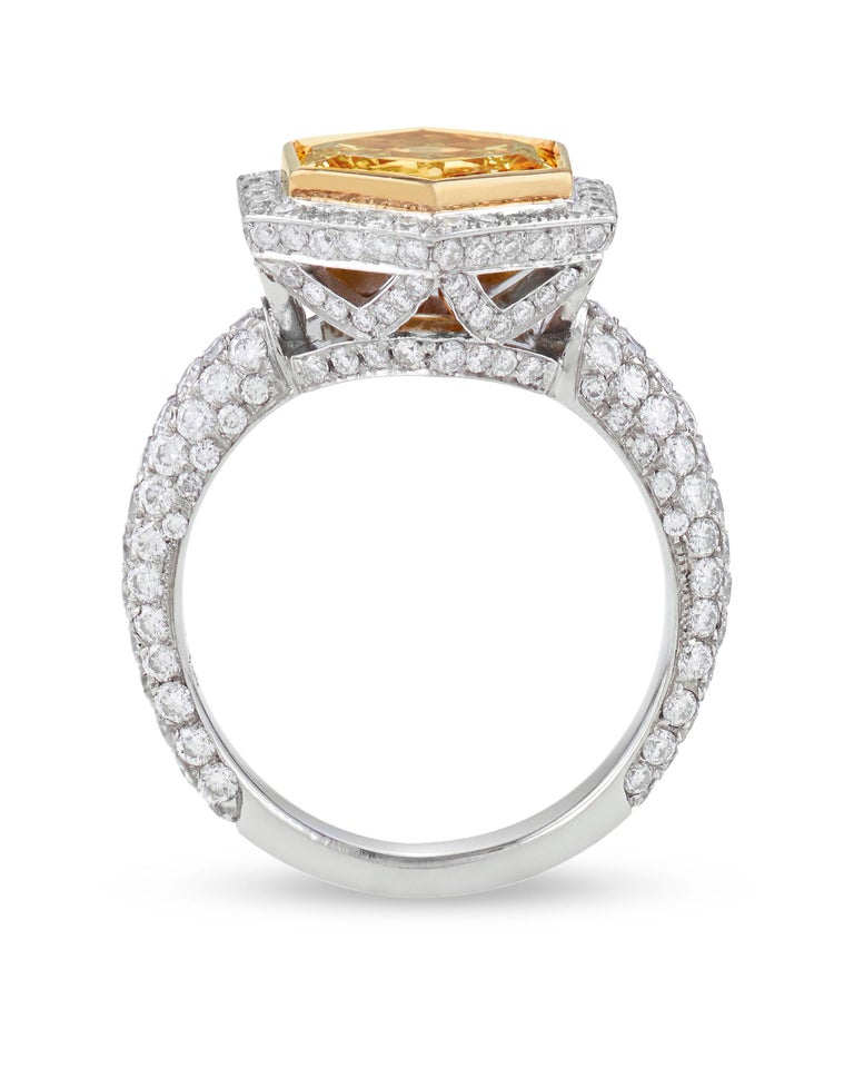 Dazzling with the radiance of pure sunshine, this exceptional fancy intense yellow diamond possesses a rare beauty. Very few diamonds attain the highly desirable fancy intense color grading - finding a yellow stone of such highly saturated color and