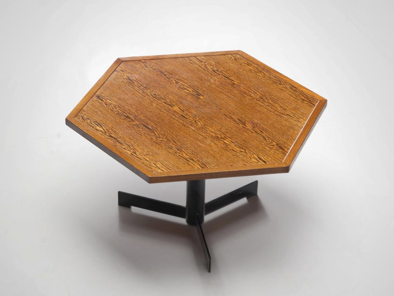 Dining table, wenge, steel, Belgium, circa 1960  This Belgium table features a hexagonal tabletop on a metal pedestal. The black pedestal consists out of a slim round base standing on three legs. With the veneered tabletop and the striped pattern